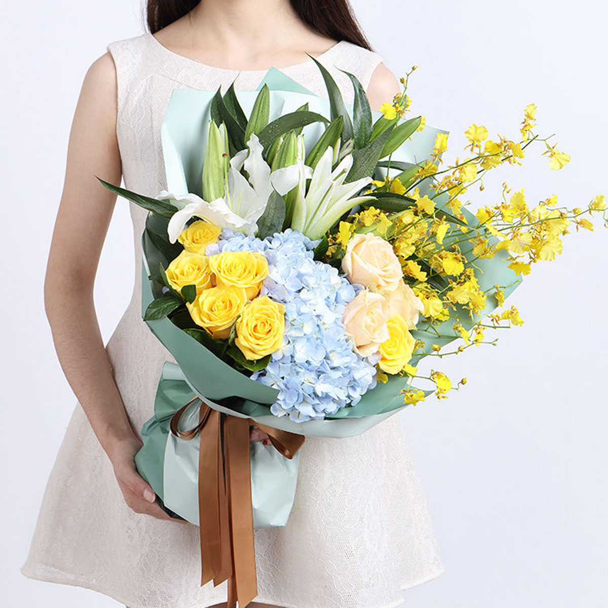 Medium bouquet of hydrangeas, orchids, roses and lilies wrapped in quality matte paper