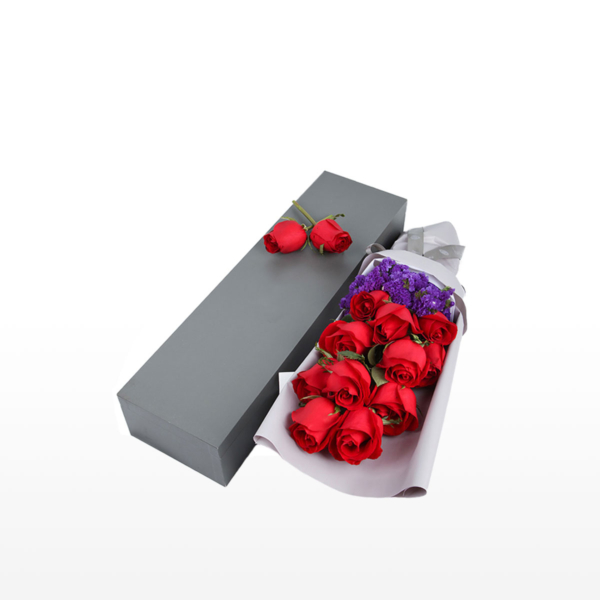 Medium bouquet of 11 red roses and purple 'forget-me-not' flowers wrapped in quality matte paper & arranged in an elegant gift box
