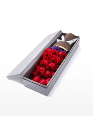 A medium bouquet of 19 red roses and purple 'forget-me-not' flowers presented in an elegant gift box