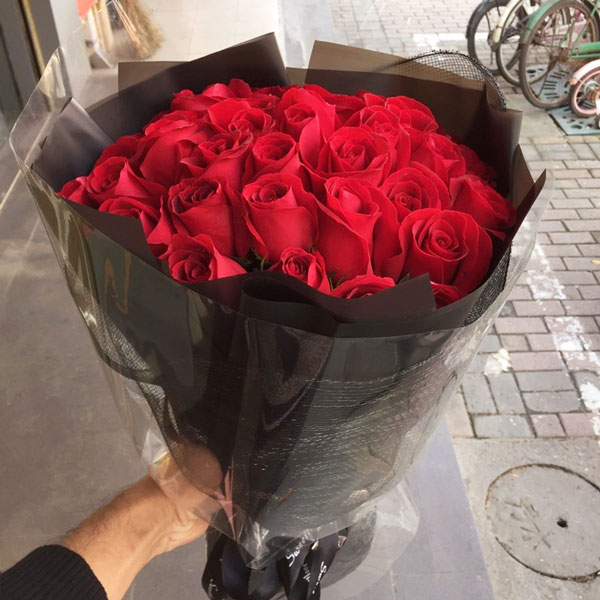 Medium bouquet of 33 premium red roses wrapped in quality matte paper