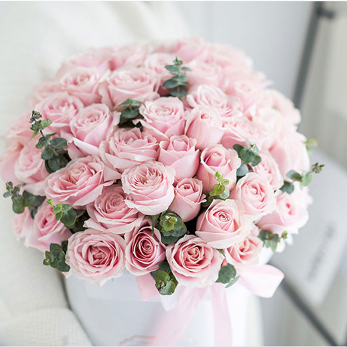 Large bouquet of 52 premium pink roses arranged in a cylinder gift box
