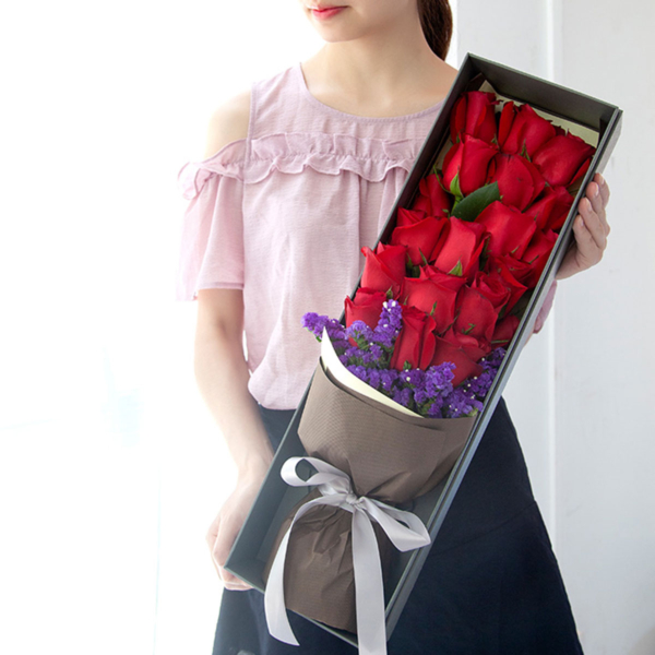 Medium bouquet of 19 red roses and purple 'forget-me-not' flowers presented in an elegant gift box