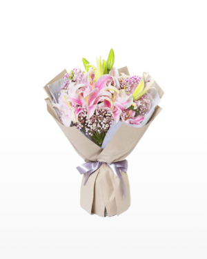 Medium bouquet of 16 pink oriental lilies and baby's breath flowers wrapped in quality matte paper