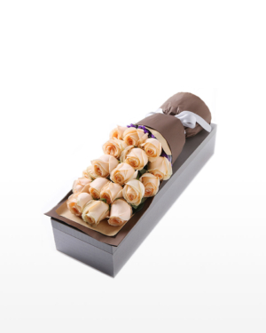 Medium bouquet of 19 yellow roses and purple 'forget-me-not' flowers wrapped in quality matte paper and arranged in an elegant gift box
